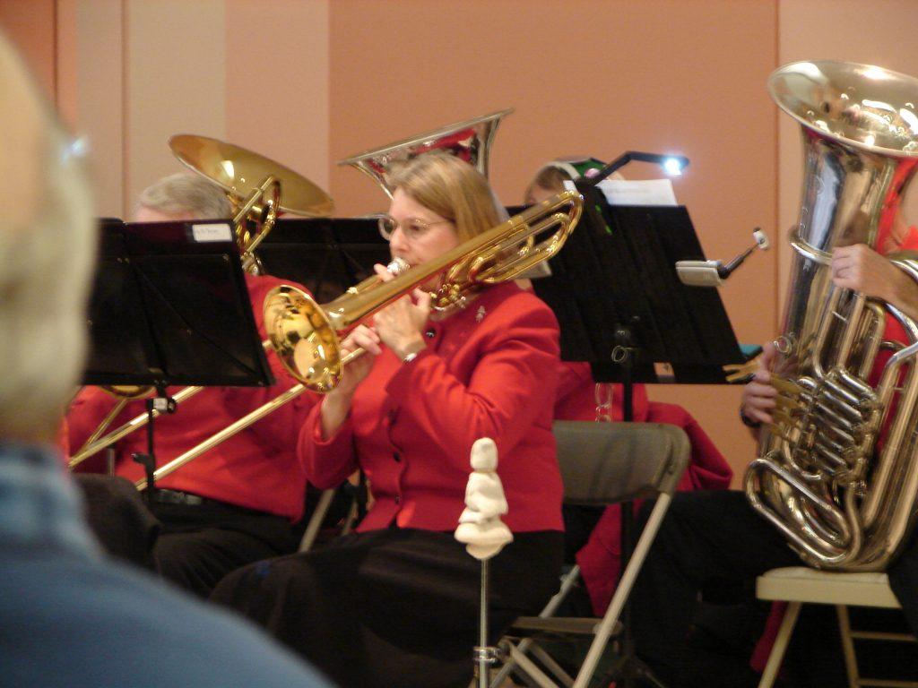 Marcia Playing Trombone-NewHorizonsBand